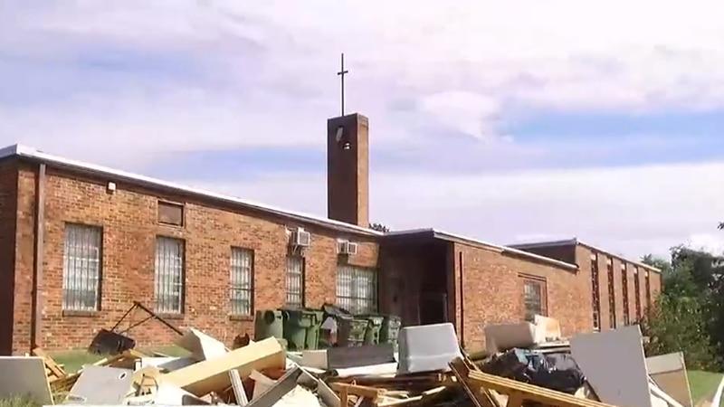 A Richmond church discovers a junkyard pile on its property