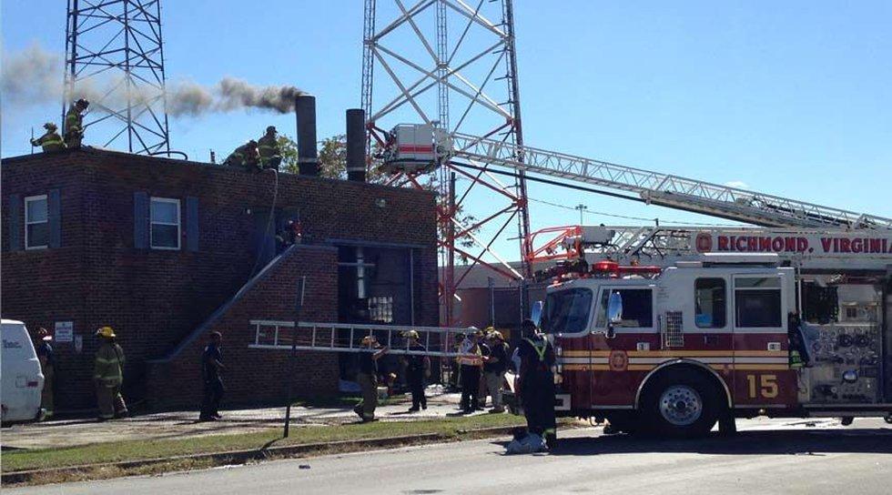 A blaze at a crematory near Mechanicsville Turnpike send plumes of heavy black smoke into the...