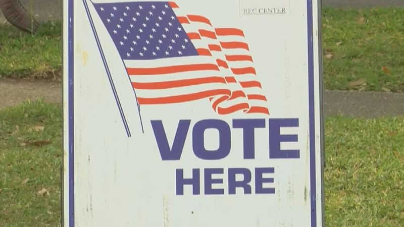 Vote here sign outside of a voting precinct.