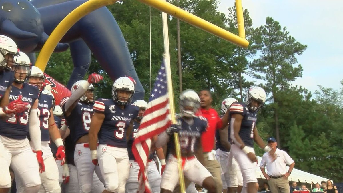 The Richmond Spiders football team gets ready to take the field for a game against Elon on...