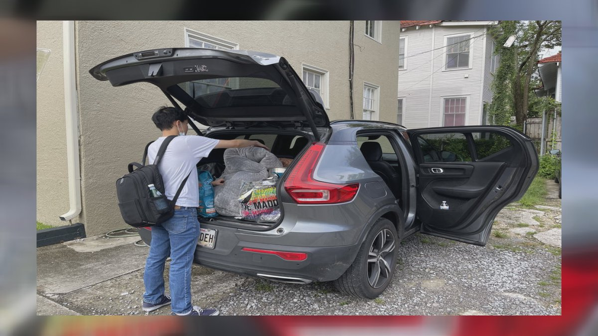 Highland's friend packing up their car and preparing to evacuate.