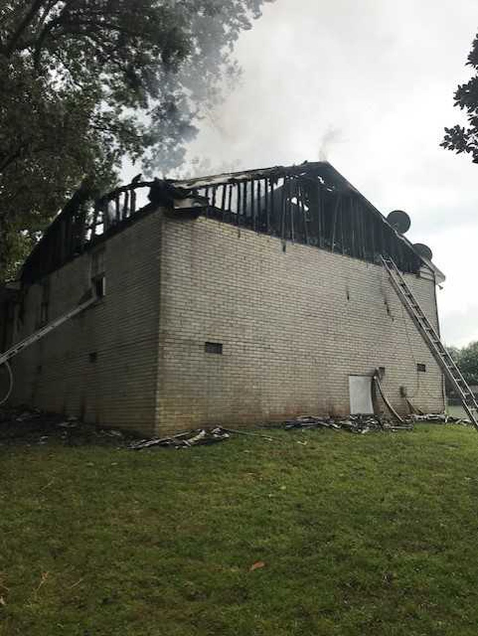 Six people were displaced and a firefighter was treated for heat exhaustion after a lightning...