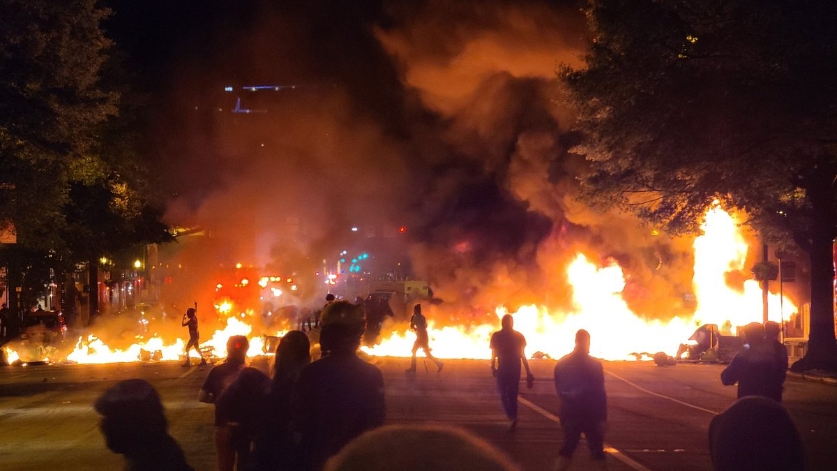 At least one person was shot as violent protests over the death of George Floyd erupted for a...