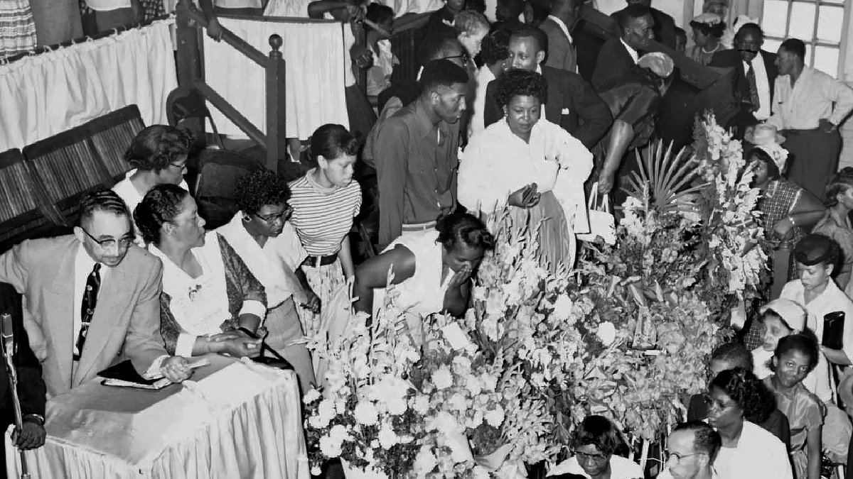 FILE - In this Sept. 3, 1955, file photo, mourners pass Emmett Till's casket in Chicago. Till...