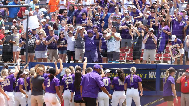 The JMU softball team upset No. 1 Oklahoma in its first-ever game in the Women's College World...
