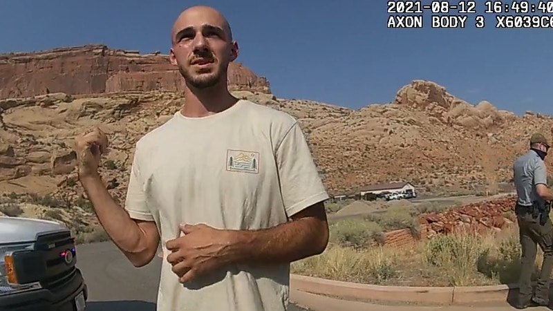 North Port, Florida, resident Brian Laundrie talks with Moab, Utah police officers as they...