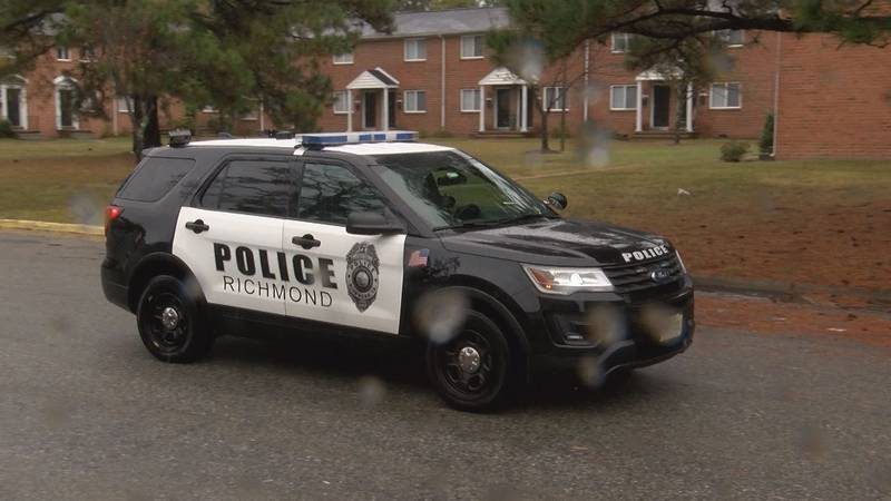 RPD Cruiser drives through Glenway Court after a shooting hours earlier.