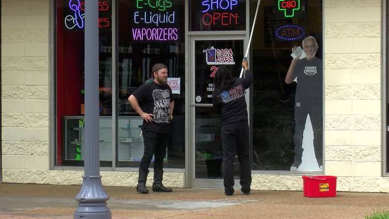 Papa Joe's smoke shop employees are making sure everything is wiped down for customers. The...
