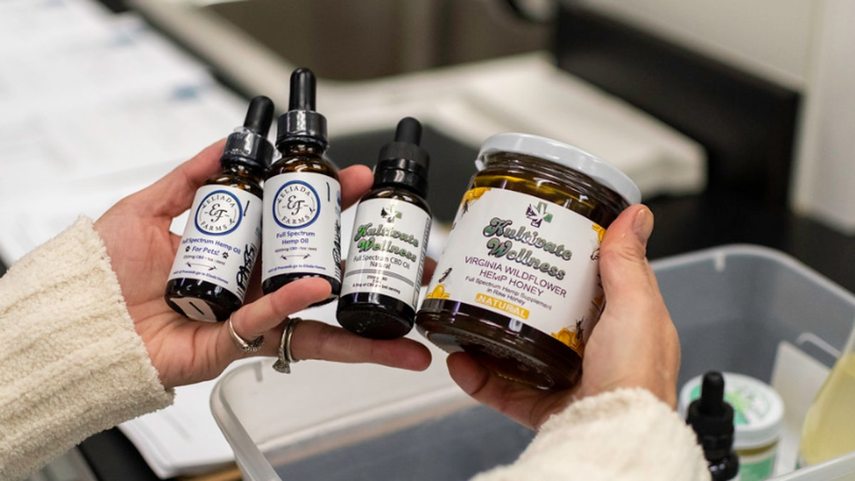 Rebecca Caffrey showing examples of the various hemp and CBD products she tests in her cannabis...