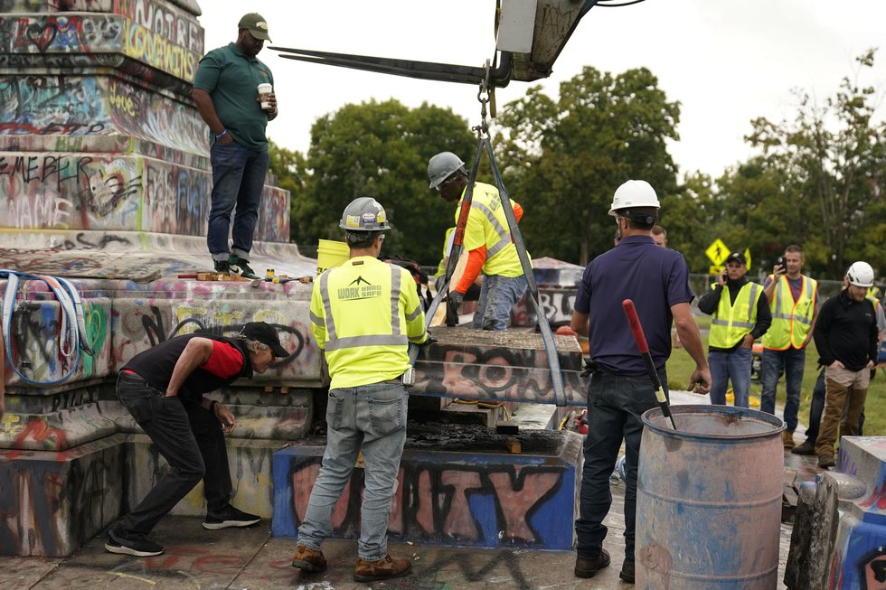 Crews move a section of the base as they attempt to locate a time capsule said to be buried in...