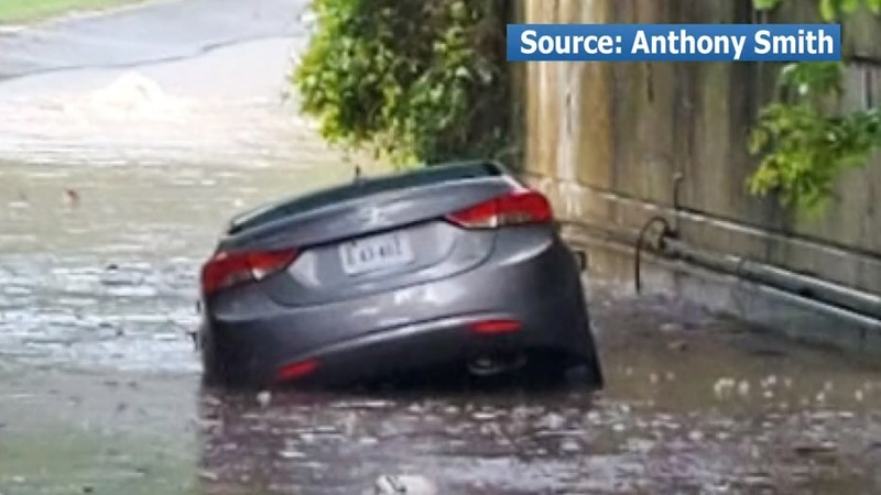 Heavy rain caused roads to flood and cars to become stuck.