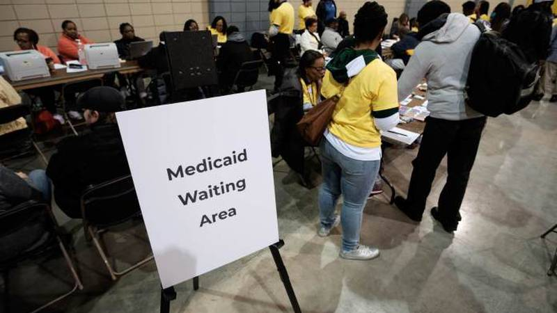 State social services workers signed up homeless residents for Medicaid at a resource fair in...