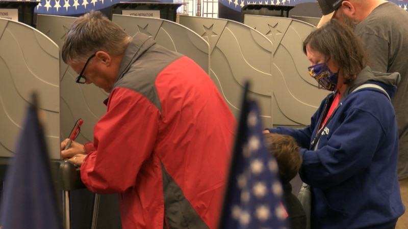 Voters could cast their ballot at Hanover's early voting center and also receive their COVID-19...
