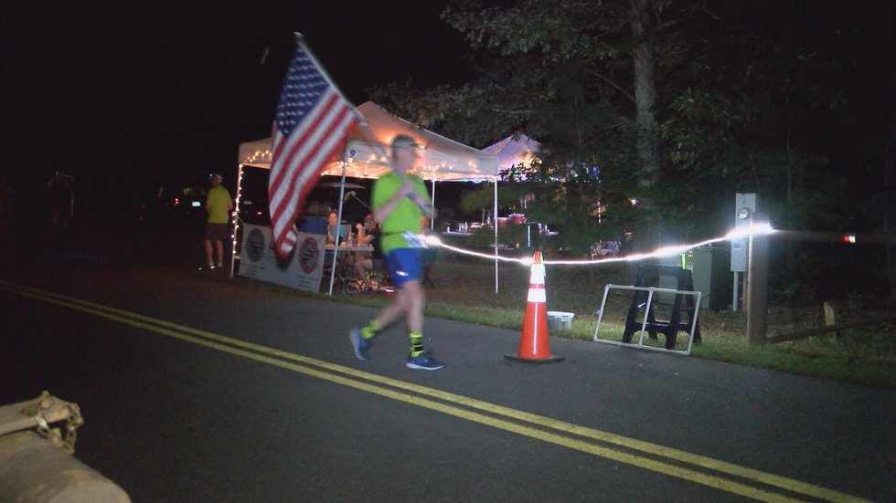 Will Turner crossing finish line of 45th Ironman race officially breaking world record.