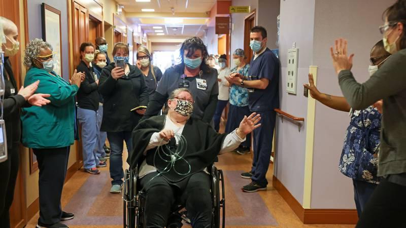 Peggy Kuehl is wheeled through Sentara Martha Jefferson Hospital after spending nearly three...