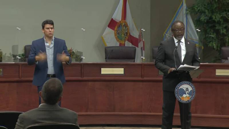 Mayor Jerry Demings of Orange County, Fla., right, is sounding the alarm as the number of...