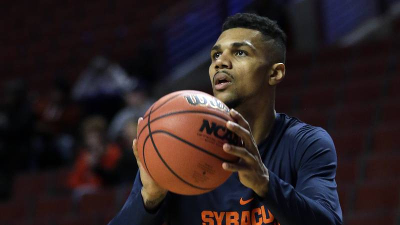 FILE - In this March 24, 2016, file photo, Syracuse's Michael Gbinije shoots during college...