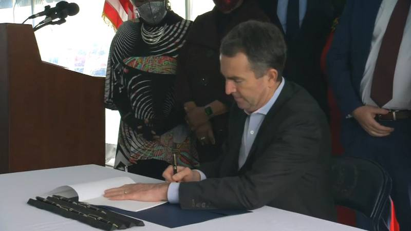 Governor Northam signing the bill abolishing the death penalty in Virginia.