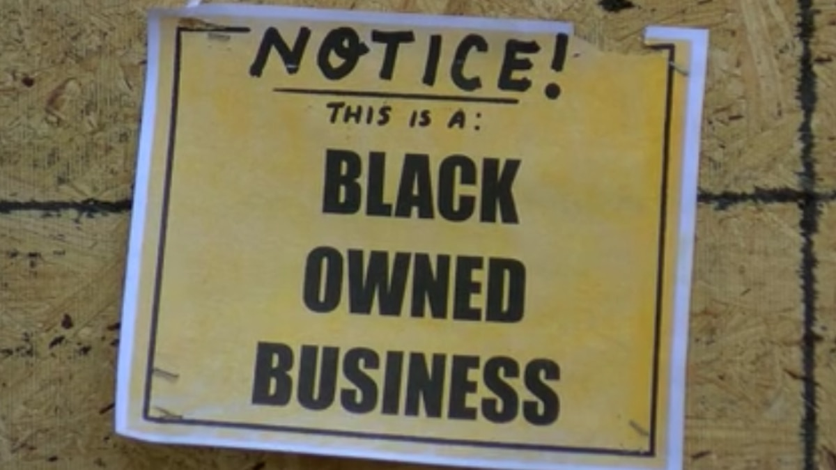 Owners post signs saying it is a black-owned business to stop vandalism and looting.