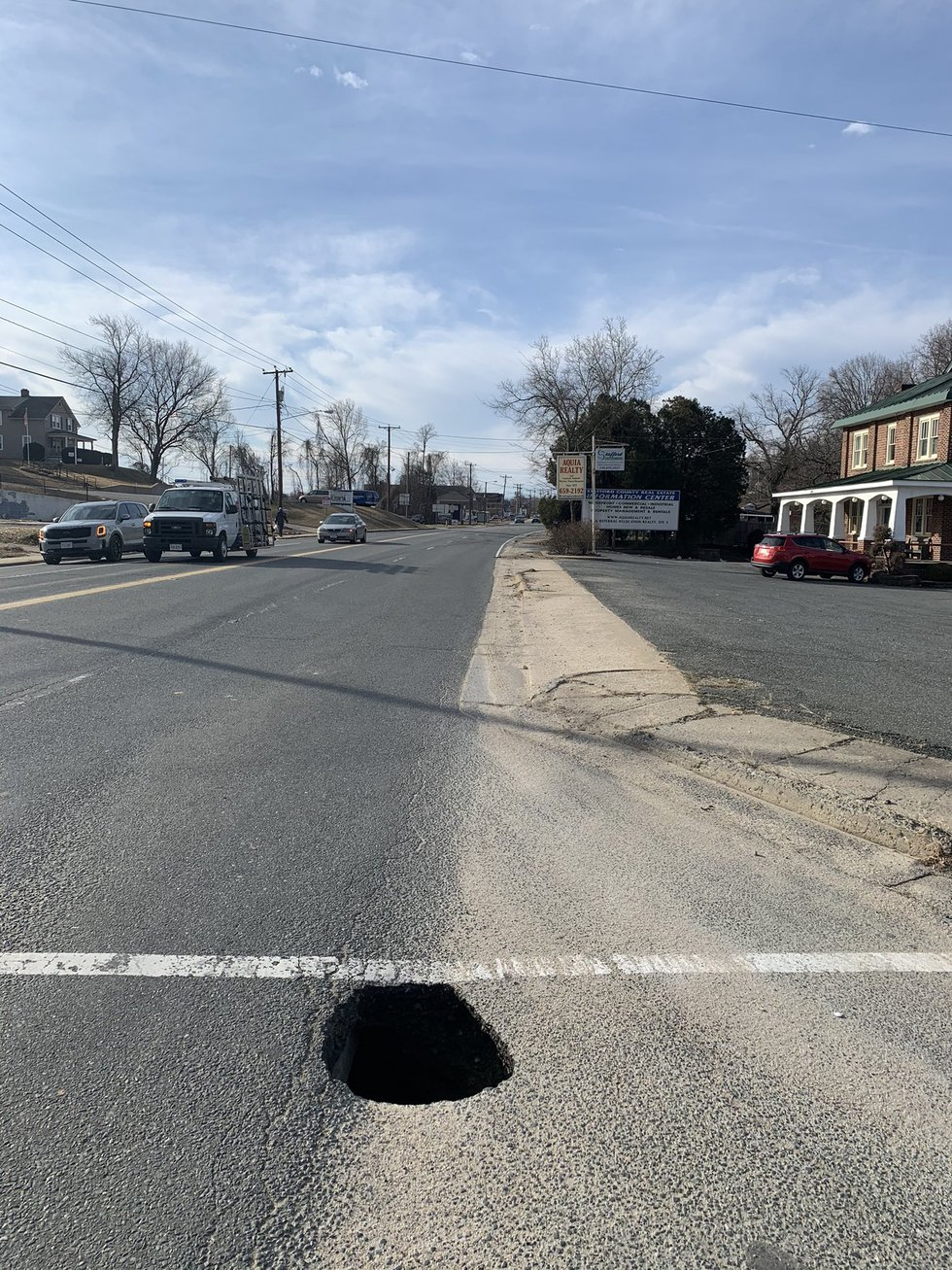 Photos posted by the Stafford County Sheriff's Office show a sinkhole that has formed near...