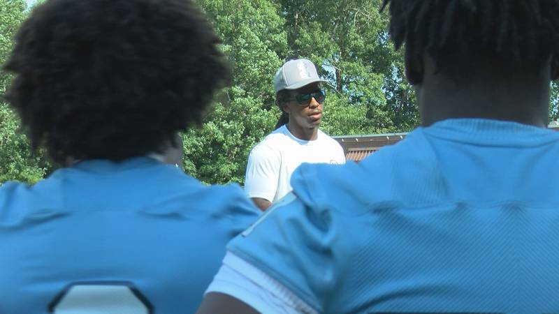 L.C. Bird and UVA grad Anthony Harris speaks at his youth football camp on July 9, 2021. Harris...