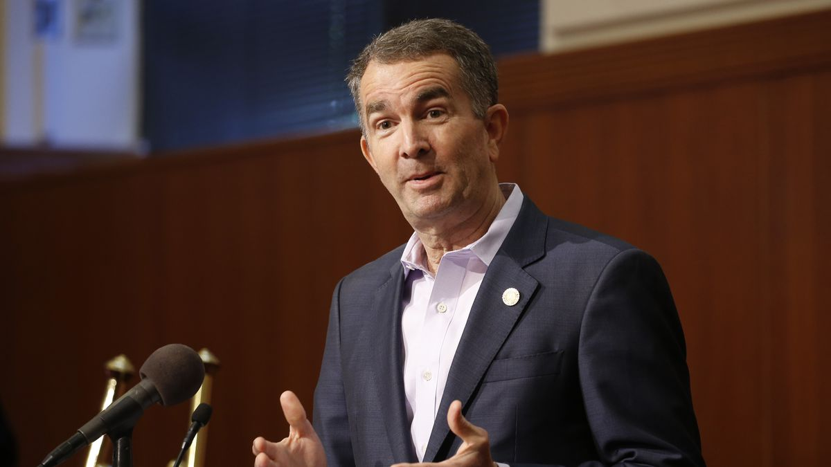 In this April 8, 2020 file photo, Virginia Gov. Ralph Northam gestures during a news conference...