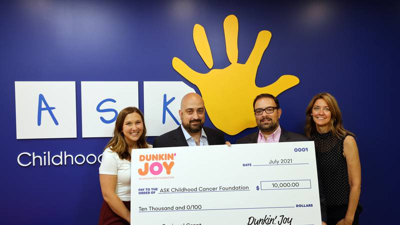 (Left to right)  Megan Angstadt, ASK Special Events Manager; Manny Cabral, Dunkin' franchisee;...