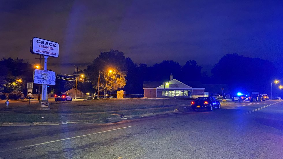 Officers are investigating a shooting in a parking lot at Grace Cleaners and Laundromat.