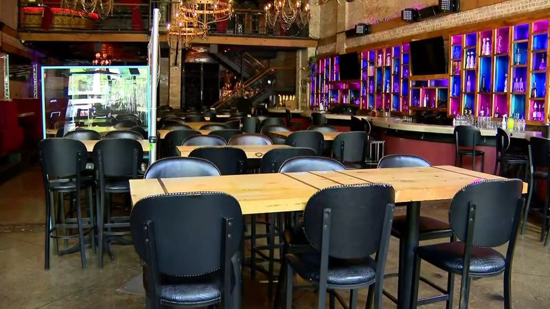 The owner of Moe's Cantina decided to divide his restaurant in two. Customers will have to show...