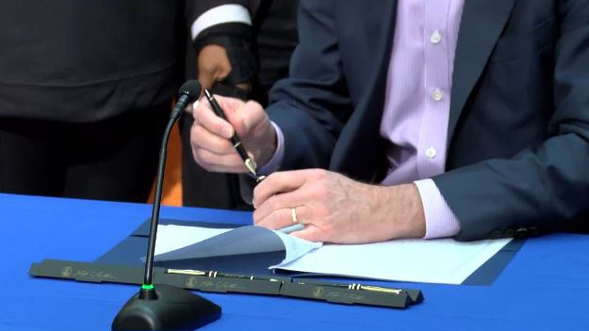 Governor Northam signing a document.