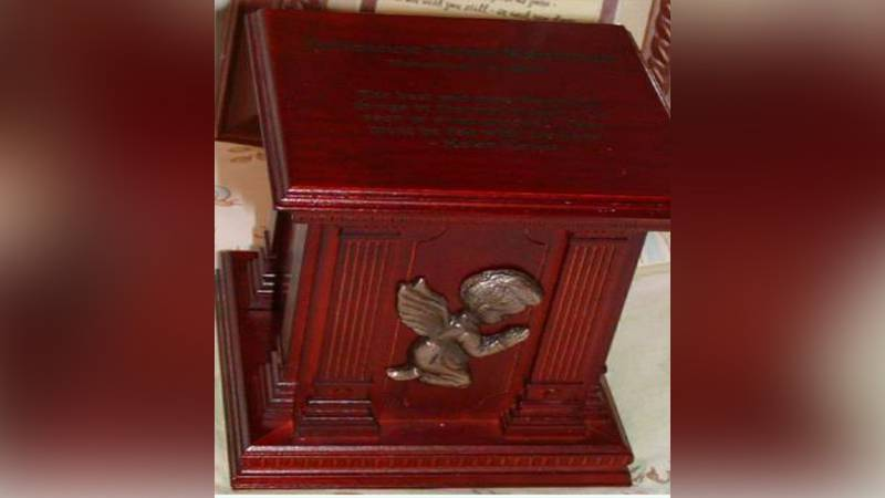 A family is desperately searching for their stillborn baby's ashes after it was stolen from...