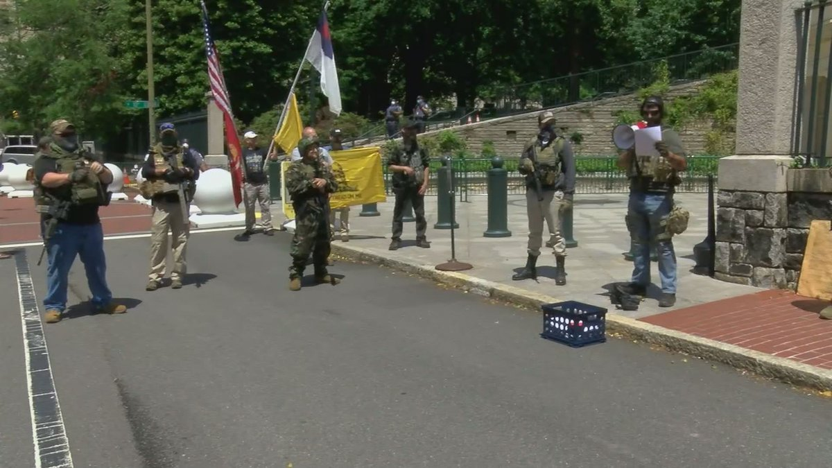 A group of armed protesters gathered near Virginia's Capitol on Friday urging Gov. Ralph...