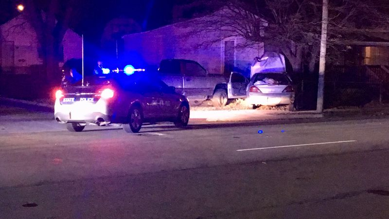 A car crashed into a home following a police chase.