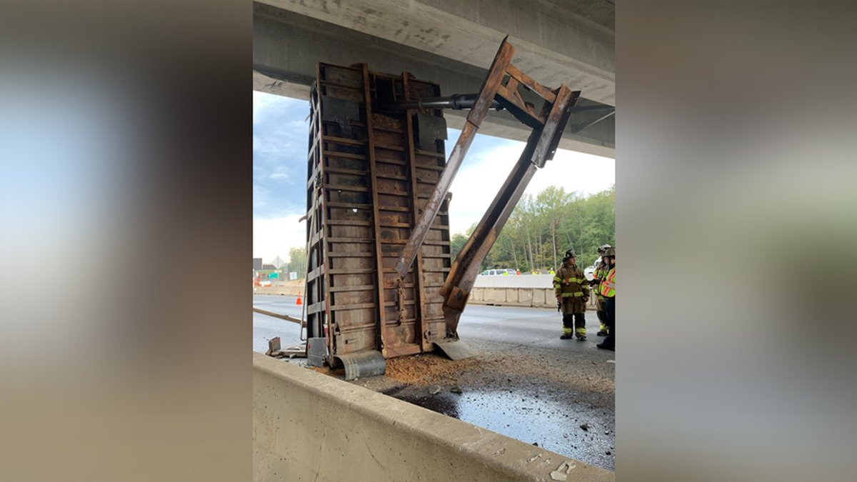 The bed of a dump truck became stuck underneath an overpass on Interstate 95 in Stafford County...