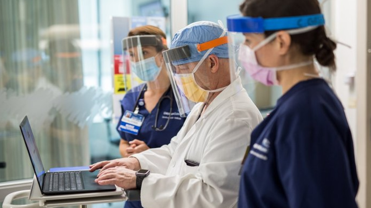 Physicians with the Carilion Clinic in Roanoke, Virginia wear enhanced personal protective...