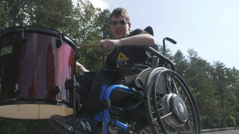 Owen Mather, a member of the WAHS Marching Band, isn't letting his disability keep him on the...