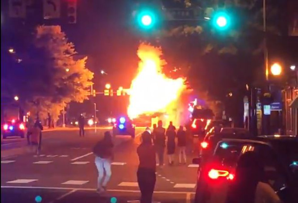 As the night turned violent, protesters set fire to a Pulse bus, leaving it destroyed.