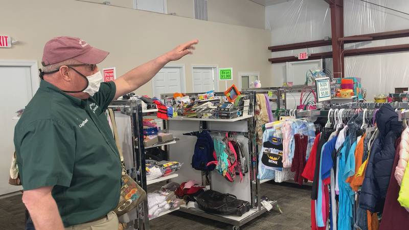 Lloyd Runnette shows off the Louisa County Resource Council's new 'Community Closet'