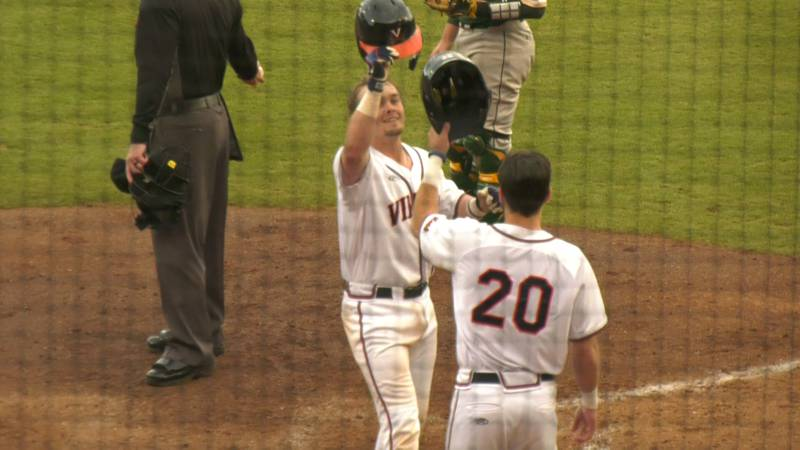 Logan Michaels celebrates the first home run of his Cavalier career