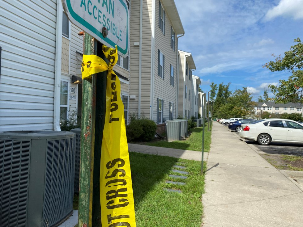 Some police tape left at the Jesse Lee Apartment complex, after Tuesday morning's double...