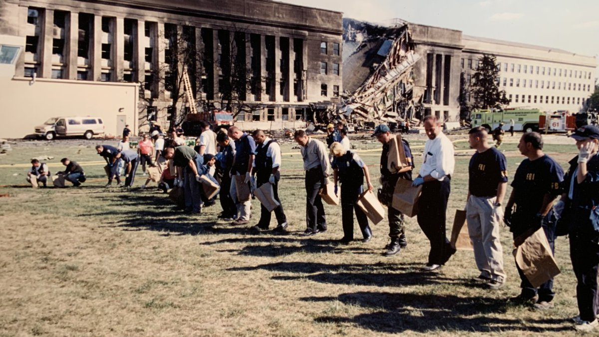 Stanley Meador and fellow Virginia Department of ABC employees search the grounds of the...