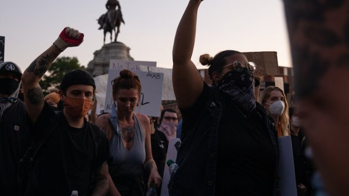 Thousands of protesters gather at the Robert E. Lee Monument for a peaceful rally in Richmond,...