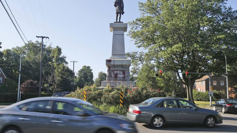 FILE - In this Aug. 22, 2018, file photo, cars pass by a statue of Confederate Gen. A.P. Hill...