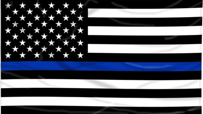 """The """"thin blue line"""" American flag suggests police stand between order and chaos, but now the..."""
