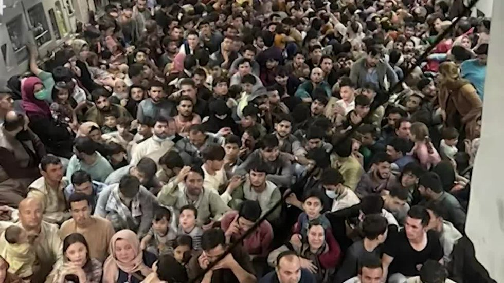 An image from the Department of Defense shows how crowded the transport planes are leaving the...