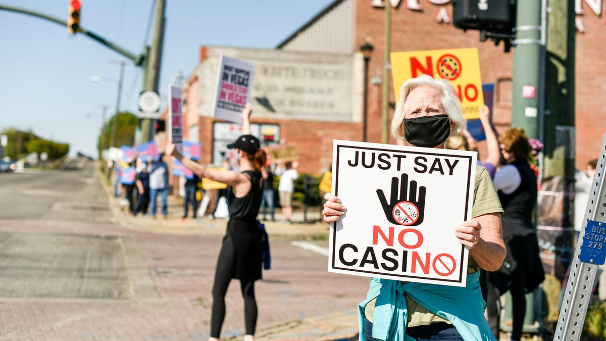 On Monday, protesters stood outside the Bow Tie theatre on Arthur Ashe Boulevard in Scott's...