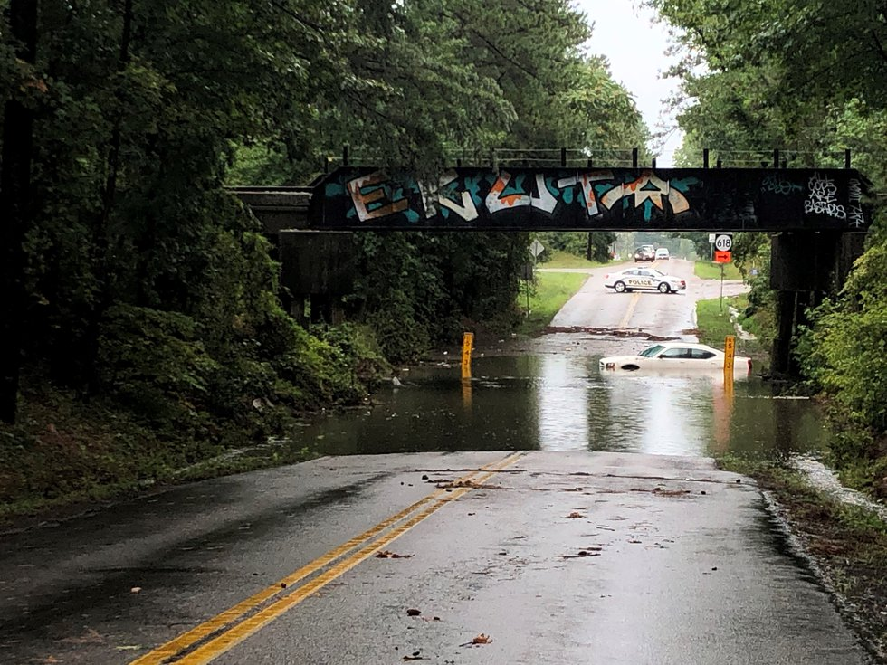 A vehicle was trapped in the high water at Ware Bottom Springs Road.