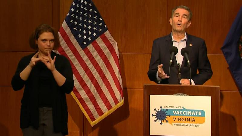 Governor Ralph Northam holding a press briefing in Richmond.