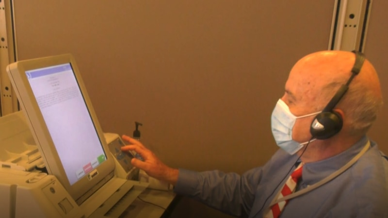 A machine called AutoMARK allows visually impaired voters some privacy.