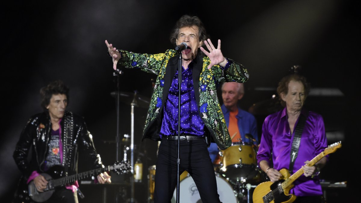 FILE - In this Aug. 22, 2019 file photo, Mick Jagger, center, performs with his Rolling Stones...